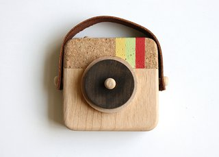 A look back at some of my favorite cameras - Photo 6 of 10 - Inspired by the photo sharing app Instagram, the nostalgic Anagram Wooden Camera, $35, sports the same striped colors (minus the blue) and is handmade from sustainable wood, cork, and leather.