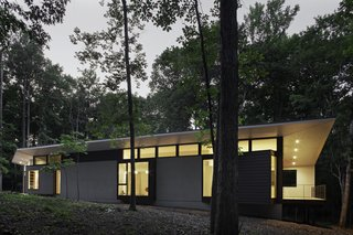 Streamlined Modern Living in the North Carolina Forest - Photo 8 of 10 -