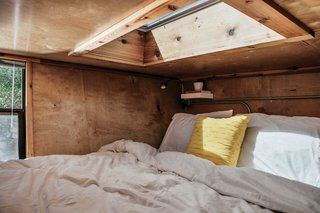 How to build a Tiny DIY Trailer on a Budget - Photo 7 of 12 - The sleeping loft features a Velux skylight. Structural insulated panels by Vantem keep heating costs down in almost any climate.