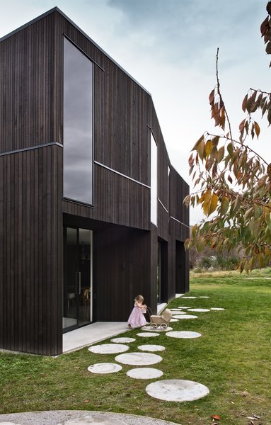 Cooke clad the building in a black-stained, sustainably-grown Canadian cedar, a durable choice that ages well and requires little maintenance. The dark glazing was chosen so windows appear seamless, accentuating the form of the building.