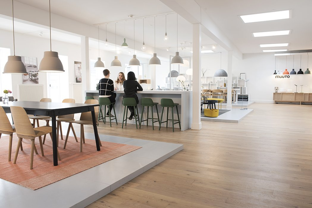 "Muuto's full collection is on display in their spacious showroom, where individual environments are dedicated to different rooms of the home. The showroom also functions as a meeting place. ""Because the number of employees at Muuto is growing, we sometimes have a lack of meeting rooms,"" explains project manager Nina Bruun. Impromptu gatherings give visitors an opportunity to see Muuto's collection come alive through organic interactions.  Photo 2 of 7 in Muuto's Sophisticated Copenhagen Office is All About Transparency"