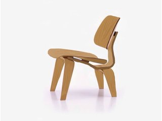 A Leg Splint Inspired Charles and Ray Eames' Famous Molded Plywood Lounge Chair - Photo 1 of 8 -