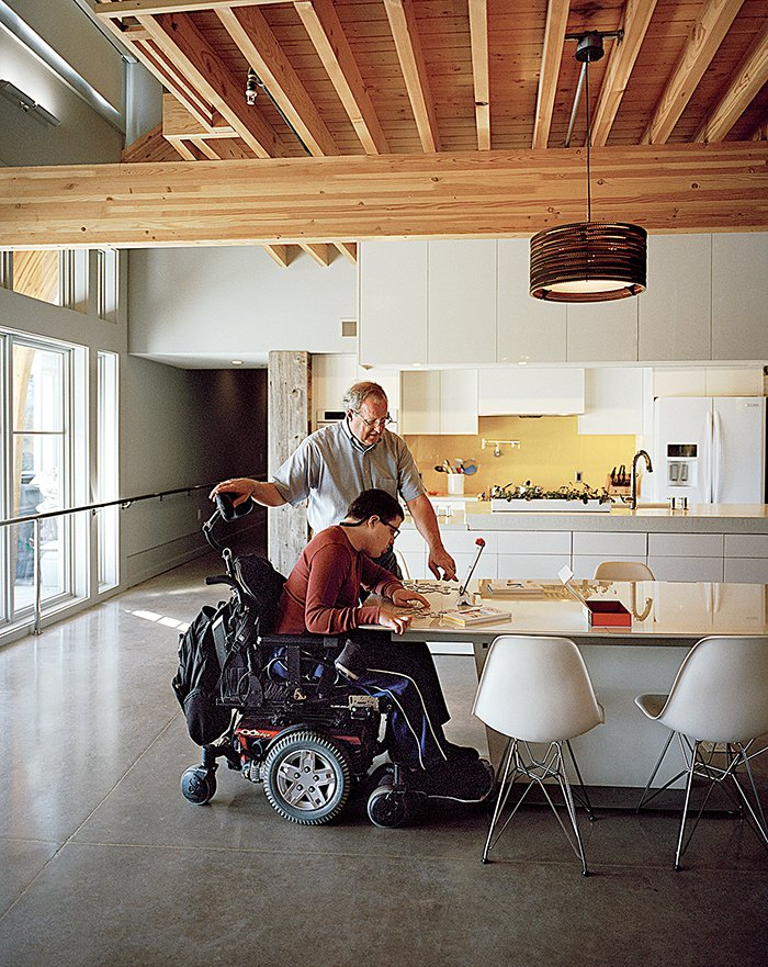 Ed Slattery, seen here with his son Matthew, wanted to create a sustainable home that is accessible without feeling like a hospital.  Photo 3 of 8 in This Impressively Accessible Home Has a Tower That Can Be Reached by Wheelchair