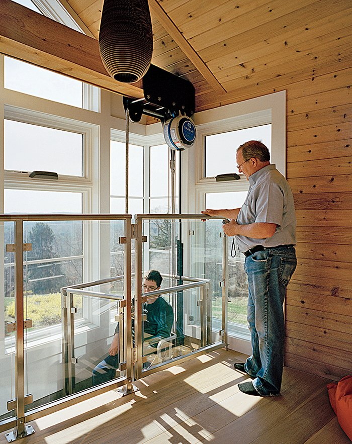 "A custom-designed chairlift system from Versicor allows Matthew access to the tower. ""The new house has really liberated Matthew. My goal is that he will have access to everything by one means or another,"" says Ed Slattery.  Photo 6 of 8 in This Impressively Accessible Home Has a Tower That Can Be Reached by Wheelchair"