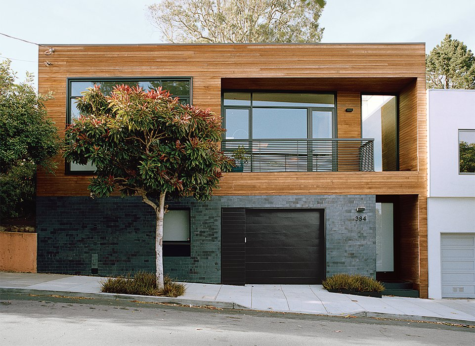 Bernstein reconfigured the entryway to the street level; guests ascend to the main living space. Ironspot clay tile and FSC-certified cedar clads the facade. Tagged: Exterior, House, Brick Siding Material, and Wood Siding Material.  Photo 2 of 13 in A Meticulous Renovation Turns a Run-Down House Into a Storage-Smart Gem