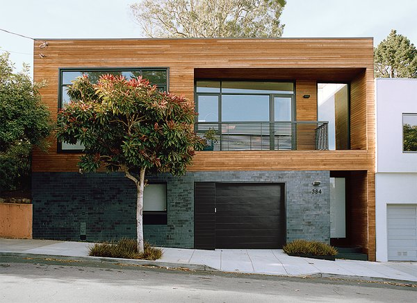 Bernstein reconfigured the entryway to the street level; guests ascend to the main living space. Ironspot clay tile and FSC-certified cedar clads the facade.