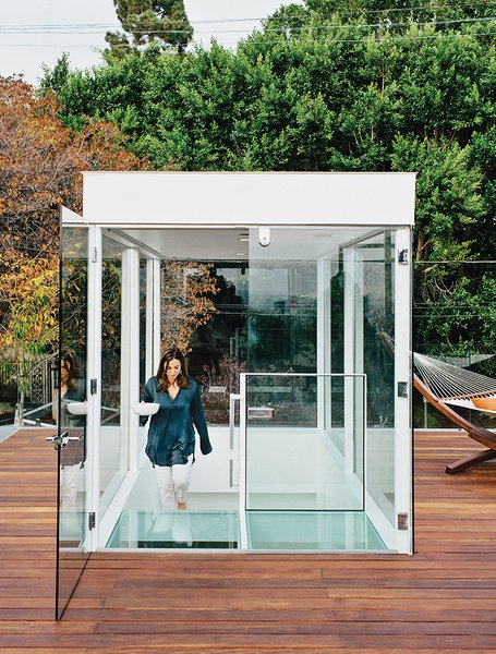 """Dimster added new, two-story-tall beams to support the weight of the glass box topping the stair. """"We were missing a grand outdoor space—that's where the roof deck comes into play,"""" Dimster says."""