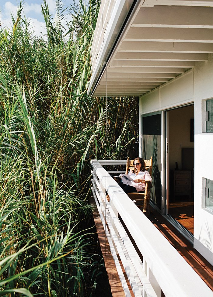 Marjorie takes to a Brumby rocking chair on the deck off the bedroom, which is privatized by a forest of bamboo.  Photo 13 of 15 in A Midcentury Home Enjoys Views from Every Angle
