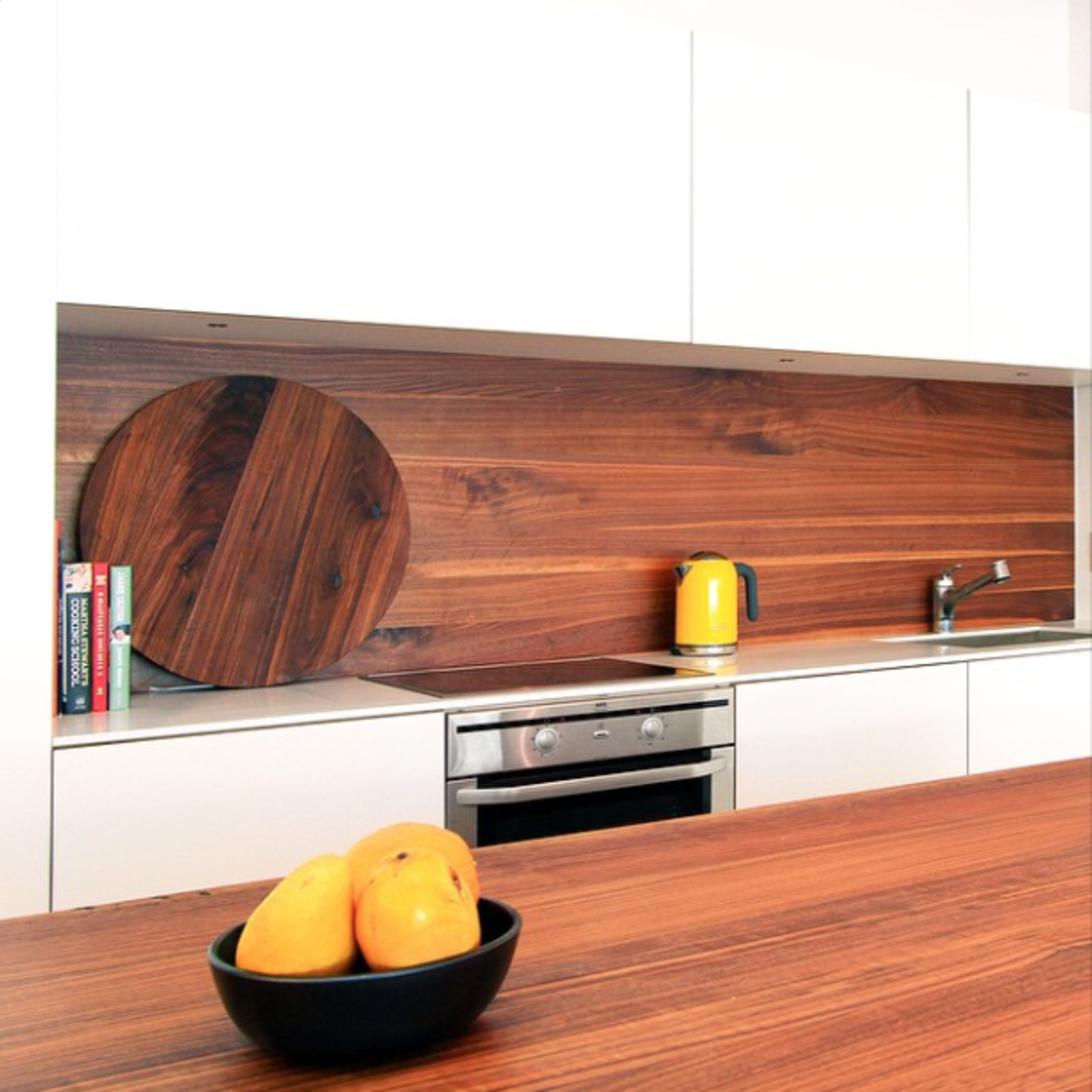 A kitchen with a wood backsplash. Tagged: Kitchen and Wood Counter.  Photo 20 of 20 in 20 Best Modern Kitchen Counters from Photo of the Week: Minimal Dream Kitchen with Wood Accents