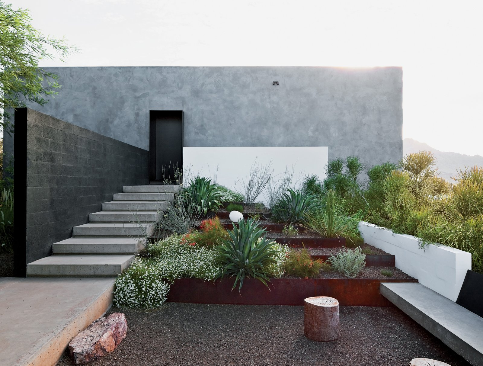 Burnette sought to maintain the property's natural vegetation and rocky ground surface. Tagged: Outdoor, Hardscapes, Desert, Raised Planters, and Small Patio, Porch, Deck.  Photo 6 of 8 in This House Doesn't Hold Back and Embraces the Desert