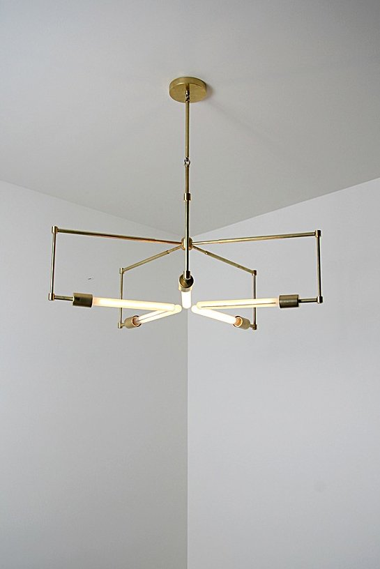 Lines of unfinished hand polished brass and exposed bulbs make up the 'Asterix'.  Lighting by Samantha Polkowski from Brass Lighting by Raymond Barberousse