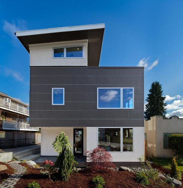 This efficient, prefabricated home was developed specifically for smaller spaces, such as this urban lot in Seattle. The design responded to the client's desire for a low-energy use home that integrates the natural beauty of the Pacific Northwestern site.  Prefab Homes by Dwell from Energy-Efficient Prefab Responds to Seattle Climate