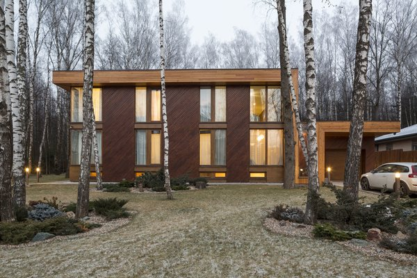 Though the house sits cozily at the back of a birch forest clearing, Zhidkov says no trees were cut during construction. Photo  of House in Moscow modern home