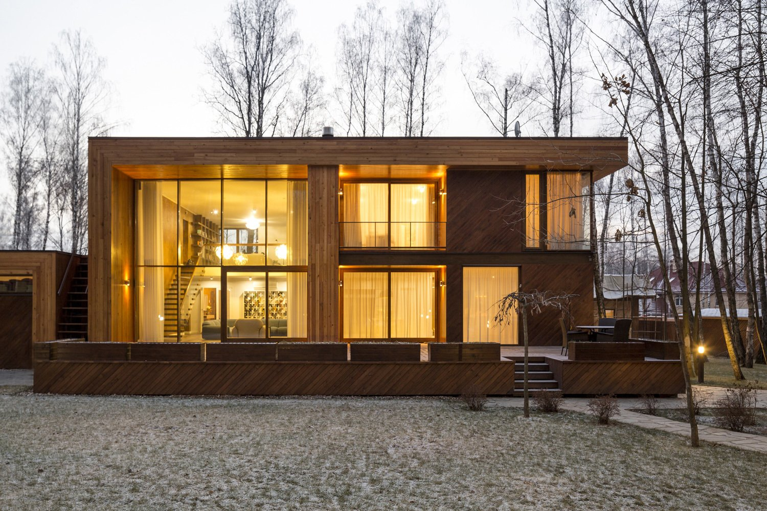 The house may be large at 5,382 square feet, but its extensive glazing makes it appear weightless.  House in Moscow by Laura C. Mallonee