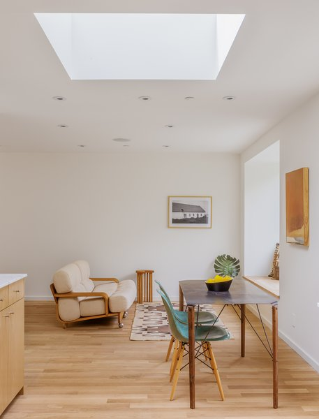 Skylights add to the apparent volume of the space, as well as performing the practical duty of providing light.
