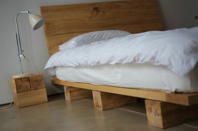A bed made from local cottonwood, supported by simple platforms.  Serene, Sustainable Home in Colorado by Sarah Amandolare