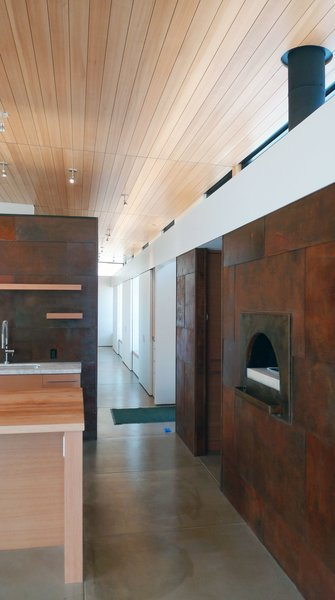 """A pizza oven and built-in storage spaces line a hallway, saving space. """"6,000-square-foot houses for single families don't make sense ecologically—or in my opinion, functionally,"""" says Hirsh. """"The house is a nice size for our life—plenty large, but not unwieldy.""""<br><br>Photo by Ron Johnson."""