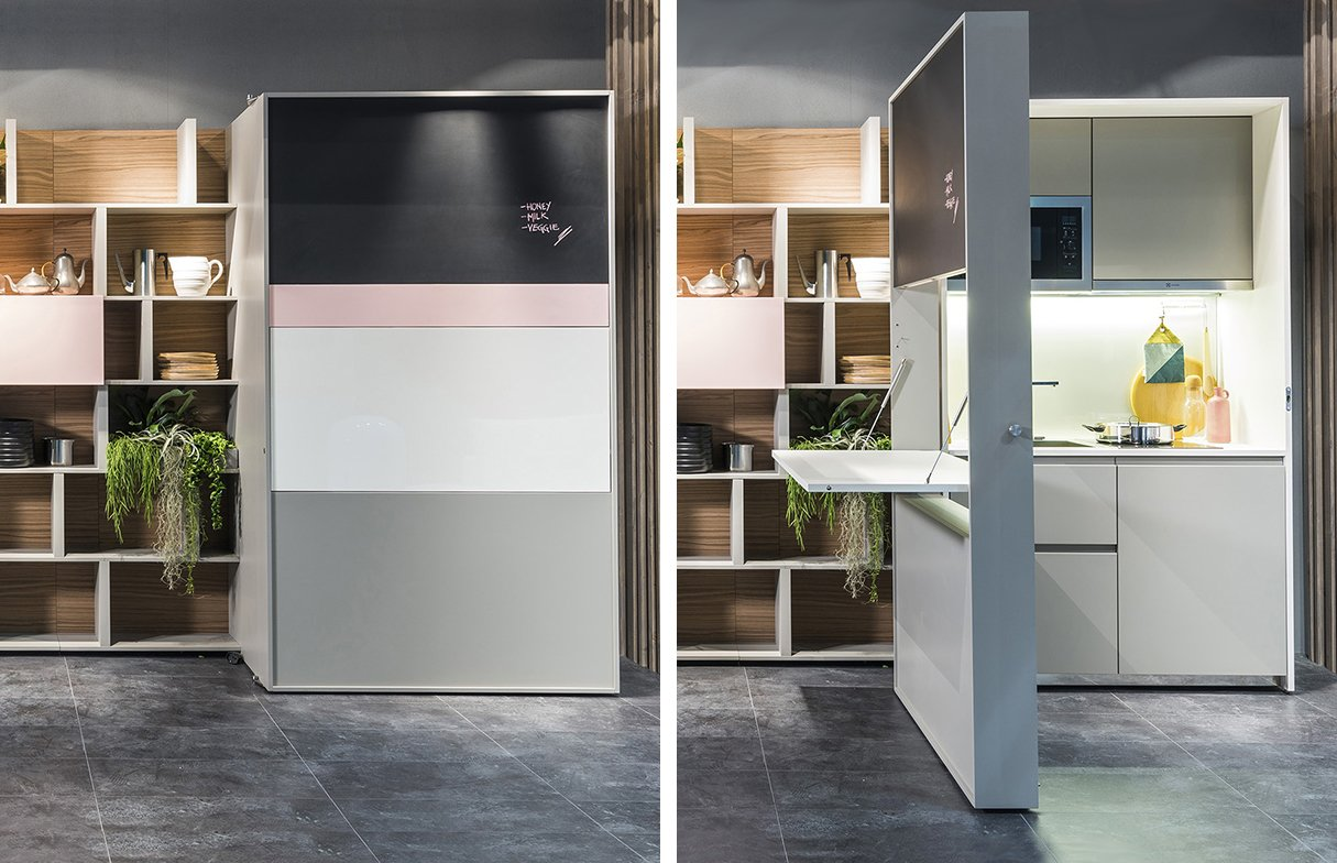 In its closed position, the piece looks like a storage unit. A door on wheels slides open to reveal a kitchen inside.  Shelves by Kristine Kwok from Genius Unfolding Kitchen Tucks Neatly Into Small Spaces