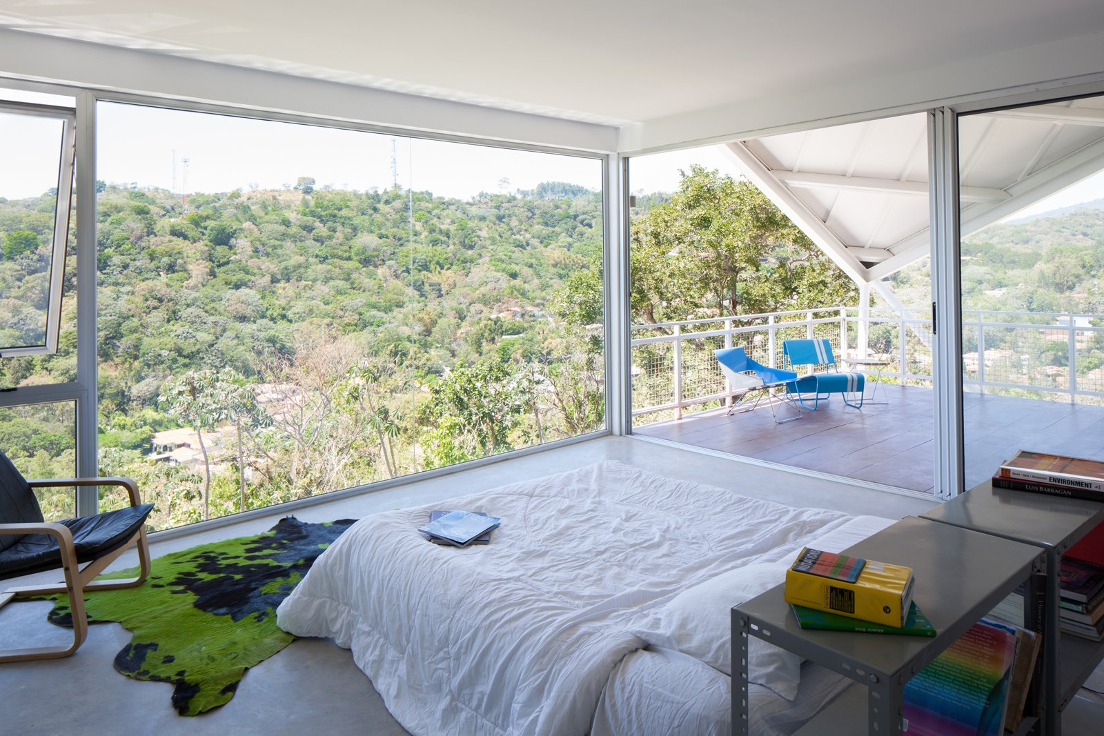 Floor-to-ceiling glass walls give the residents the illusion of living outdoors.  Photo 7 of 7 in Striking Green House with a View in El Salvador