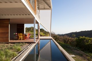 Striking Green House with a View in El Salvador - Photo 4 of 7 - The back patio overlooks a swath of forest.