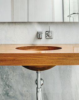 Inspired Indoor Teak Looks - Photo 1 of 14 - Breakfast Woodworks created the custom teak vanity in the master bathroom.