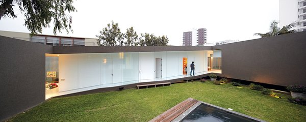 At once part of the city and protected from it, the house benefits from plenty of open space and light and creates its own courtyard enclosure.