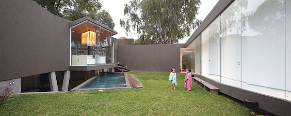 Lisette requested the central work island, which cantilevers over the pool.
