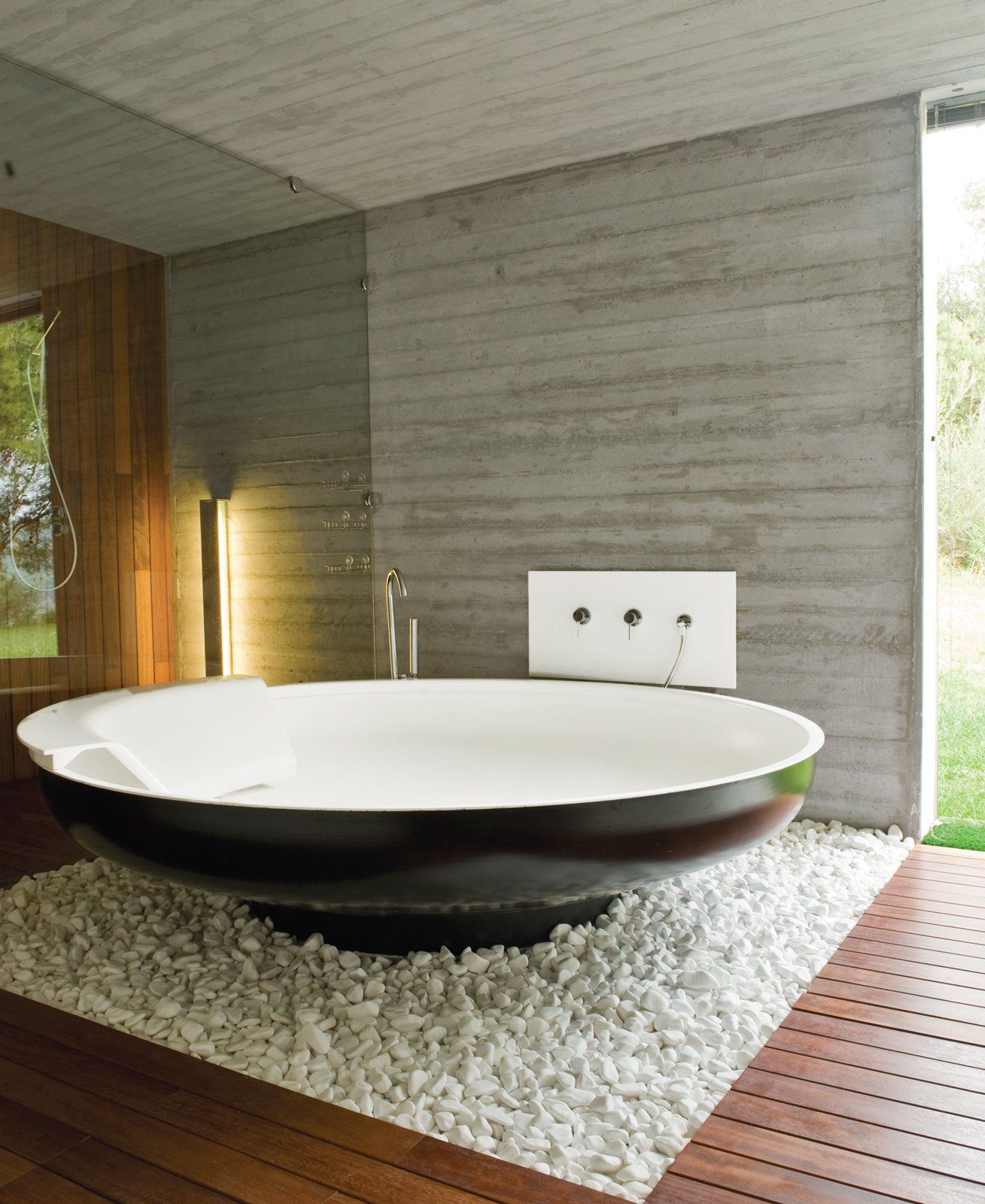 A UFO bathtub by Benedini Associati for Agape lends an alien touch to one of the master bathrooms.