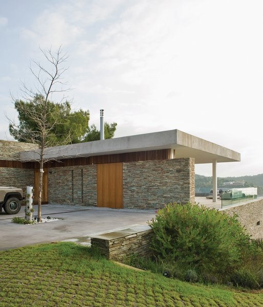 """In an effort to root the home to its location, the team elected to use dry-stacked slate quarried from a nearby island for much of the main structure. """"These walls are common in the Pelion area of Greece,"""" says Achilleas."""