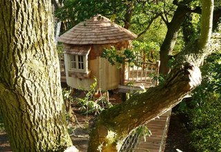 Photo Essay: Enchanting Tree Houses - Photo 8 of 24 - Founded by a Simon Parfett, a former climate scientist who wanted to do more work with his hands, Bower House Construction designs and builds custom treehouses out of Bruton, a rural town near Somerset, England. While the entire operation may seem a bit Middle-earth, Parfett's bespoke structures speak to a love of craft and nature. From custom creations for hotels to the small Pod pictured above, a wooden prefab of sorts meant for those looking for an extra room, his designs are as flexible as a sapling.