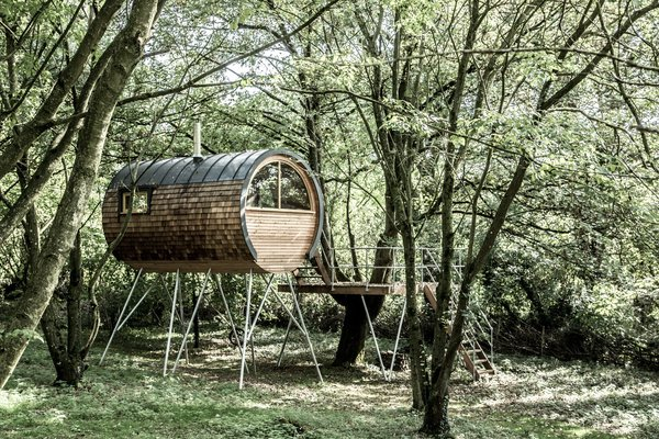 """Photo Essay: Enchanting Tree Houses - Photo 18 of 24 - One of the models Parfett designs is the Tube, a slender room that can be built off site. Mellen says the company wants to do more """"off-the-peg"""" designs like the Tube and Pod, to add more affordable and easily integrated models. Each tree house is assembled in pieces via sophisticated computer technology in a warehouse to maximize control and minimize waste and on-site disturbance."""