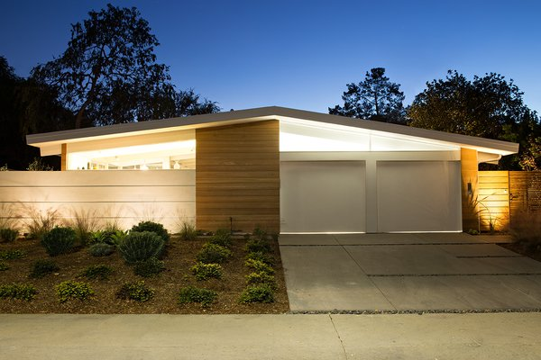 From the street, the home bears many of the hallmarks of an Eichler home. Its low roofline is in large part supported by glass walls. Clear cedar siding provides additional warmth. The exterior tiles used around the house are actually custom poured concrete from RJ & Associates Landscape Specialists.