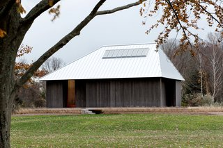 Guide to 7 Main Types of Roofs and What You Need to Know About Them - Photo 8 of 15 - The high pitch and asymmetrical shape of this standing seam metal hip roof by architecture firm P.R.O. gives it a distinct, dramatic appearance.