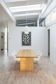 What Are Eichler Homes and Why Do People Love Them? - Photo 7 of 8 - In this renovation of a Northern California Eichler home, the area that was formerly the atrium now houses the dining room. The transom windows keep the space bright and airy.