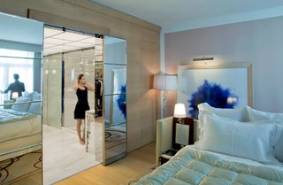 Raffles Paris: A True Art Hotel - Photo 7 of 10 - A guest room with a sliding tiled glass door leading to the luxurious bathroom.
