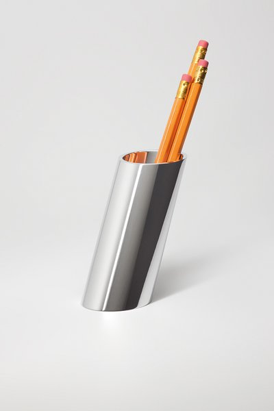 Pen Holder, $240—Easily deposit and withdraw any writing utensil with this angled polished aluminum holder. Photo by: Rodrick Bond