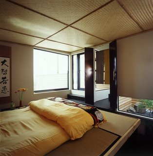 This Japanese-Style Box Home Boasts a Two-Story Bookcase - Photo 3 of 7 -