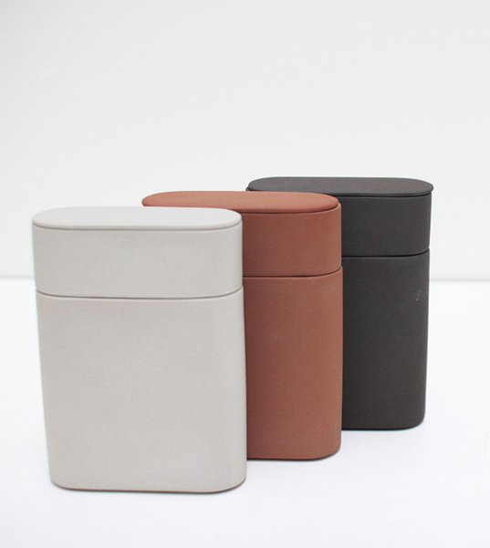 Tea Caddy Set—Skillfully made of smooth clay, this storage-friendly tea set includes a traditional bamboo caddy spoon. Available in brown, light grey, and dark grey.