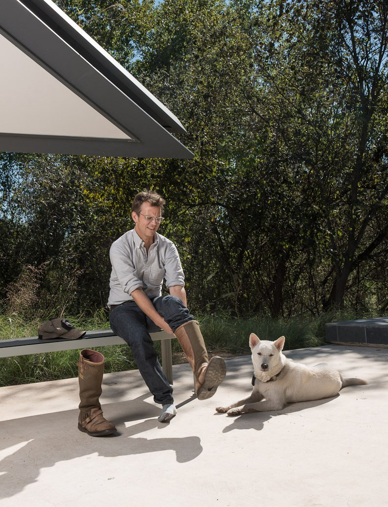 Home owner Chris Brown and his beloved dog Katsu get ready to take Dave on a tour of the Edgeland House land.  Photo 13 of 25 in 25 Dogs Living in the Modern World from Photographer Q&A: Dave Mead