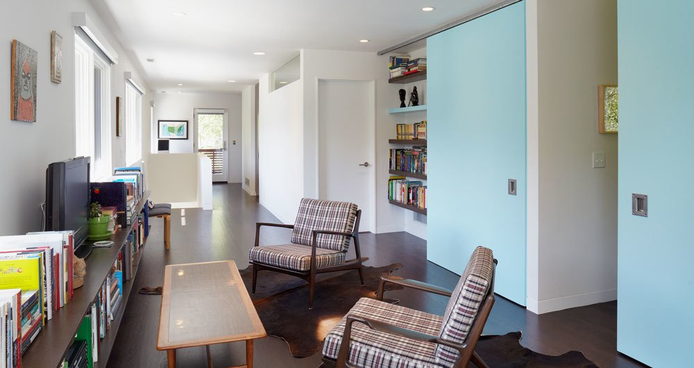 Custom powder-blue sliding doors on a track from Henderson lead to the kids' rooms.  Photo 3 of 6 in Renovating a Modern House in a Historic District