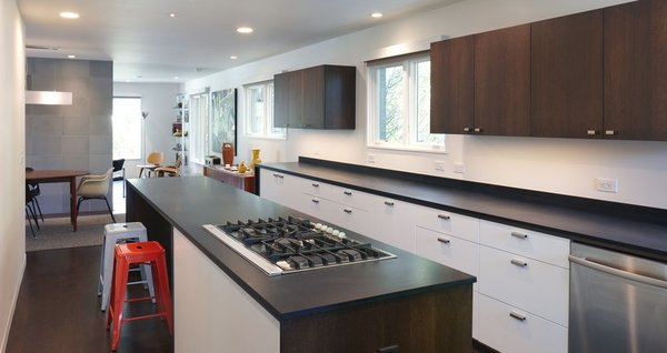 Paperstone countertops and custom cabinets outfit the kitchen. The cooktop is by Whirlpool.