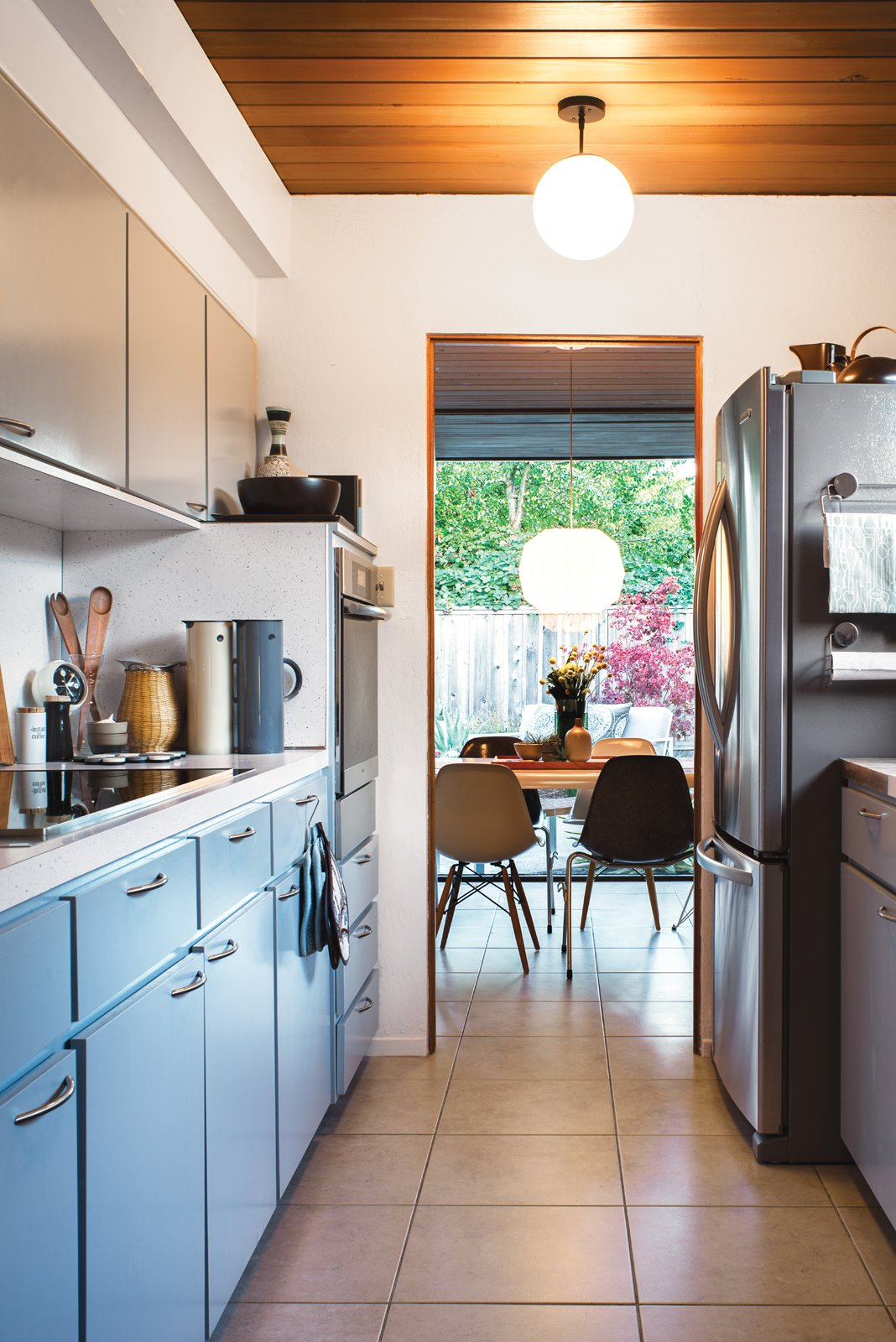 The kitchen in the couple's home retains its original cabinetry.  Modern Eichler Renovations by Allie Weiss from Modern Furniture Fit for a Classic Eichler