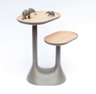 Product Spotlight: Baobab Coffee Table - Photo 2 of 2 - With a thick base and two rotating trays positioned at different heights, the lacquered lime-wood table can also function as a bedside table or decorative object. Photo by: Benjamin Graindorge