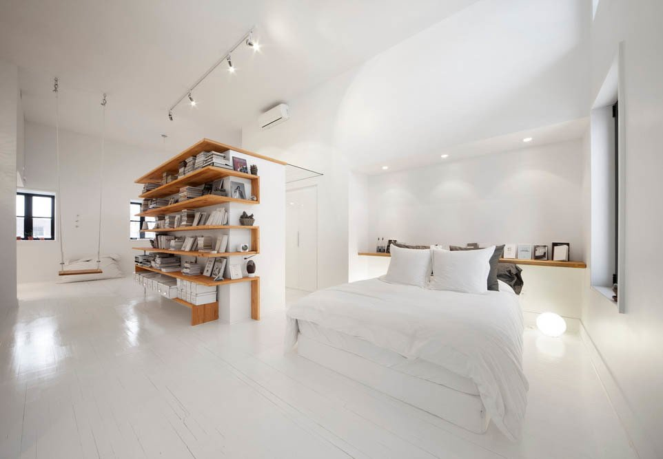 The architecture firm L. McComber Itée demolished a sloping ceiling in this Montreal attic to create a bright, roomy live-work space.  Photo 1 of 6 in A Transformative Attic Renovation in Montreal