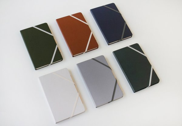 The durable, water-resistant covered book with an elastic closure comes in six colors: pale gray, clay, slate, terra cotta, hunter, and oxford.