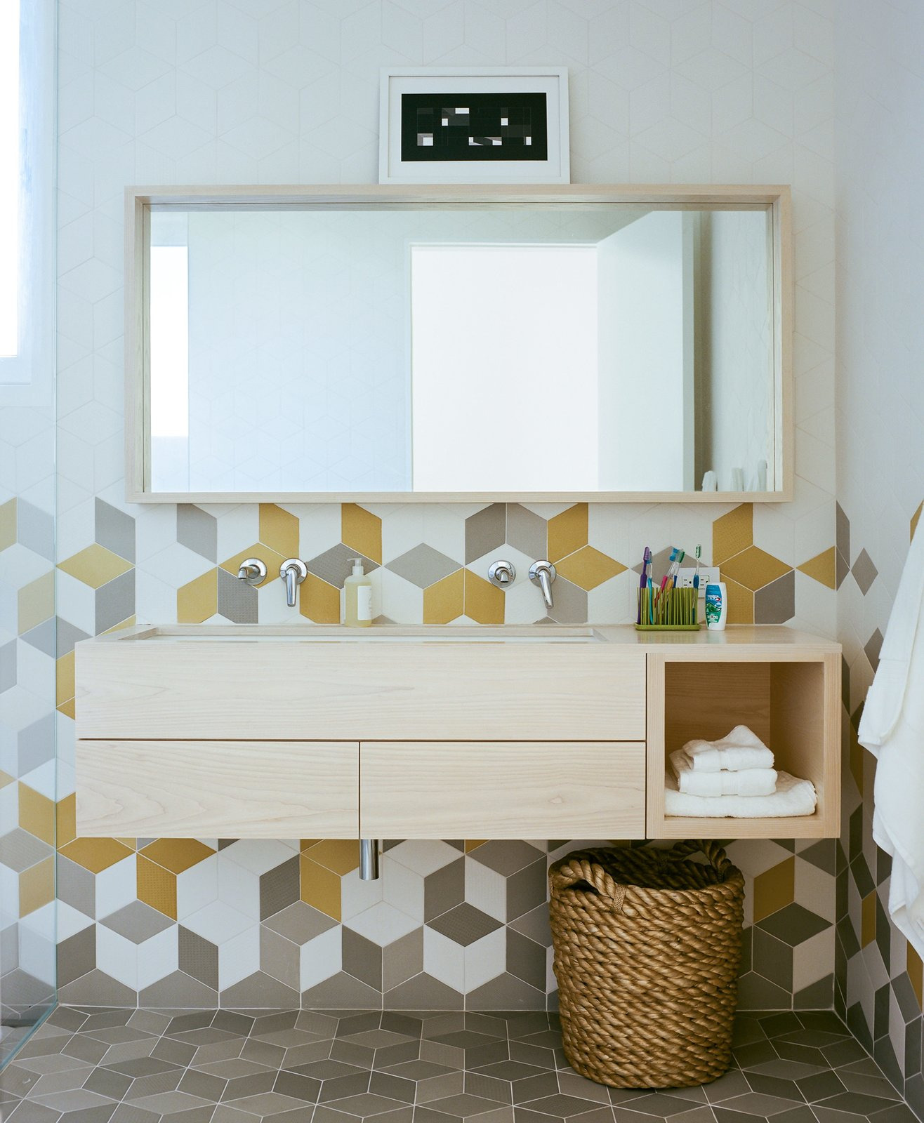 The second-floor bathroom's colorful Tex tiles from Mutina sport an array of different textures for a unique tactile experience.  Photo 10 of 16 in An Idyllic Rhode Island Summer Cottage Is the Perfect Escape for a New York Family