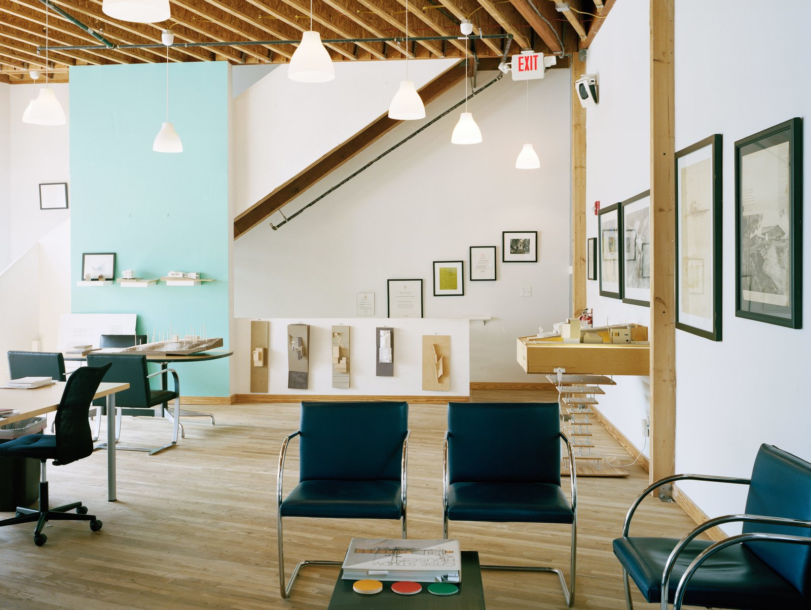 """A building can have far greater impact than the space it stands in.""—William Carpenter, architect and resident Tagged: Living Room, Chair, Coffee Tables, Console Tables, Light Hardwood Floor, Ceiling Lighting, and Pendant Lighting.  Photo 2 of 12 in A Home, Studio, and Gallery Support a Growing Art Scene in Georgia"