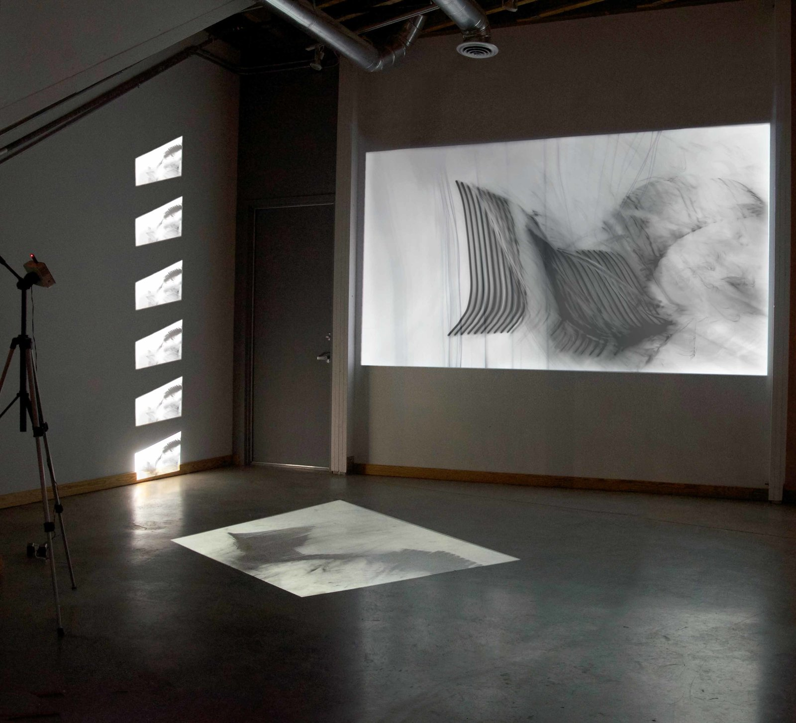 A new Lightroom exhibit by multimedia artist Bojana Ginn is set to open at the end of January 2016. Here, a three-channel video installation reinterprets the act of drawing through a new medium. Tagged: Shed & Studio, Living Space, and Den.  Photo 11 of 12 in A Home, Studio, and Gallery Support a Growing Art Scene in Georgia