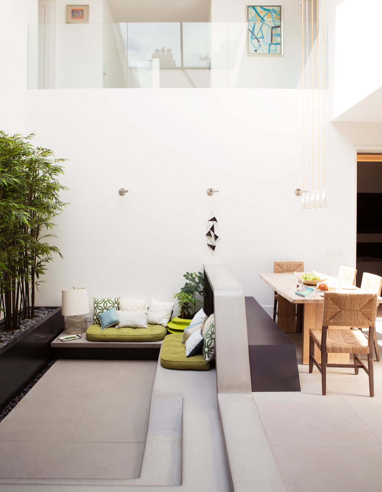 Taking advantage of the improved atrium was a priority. Tagged: Living Room, Bench, and Concrete Floor.  Photo 4 of 13 in An Impressive 20-Foot Skylight Transforms a Jumbled Chicago Home
