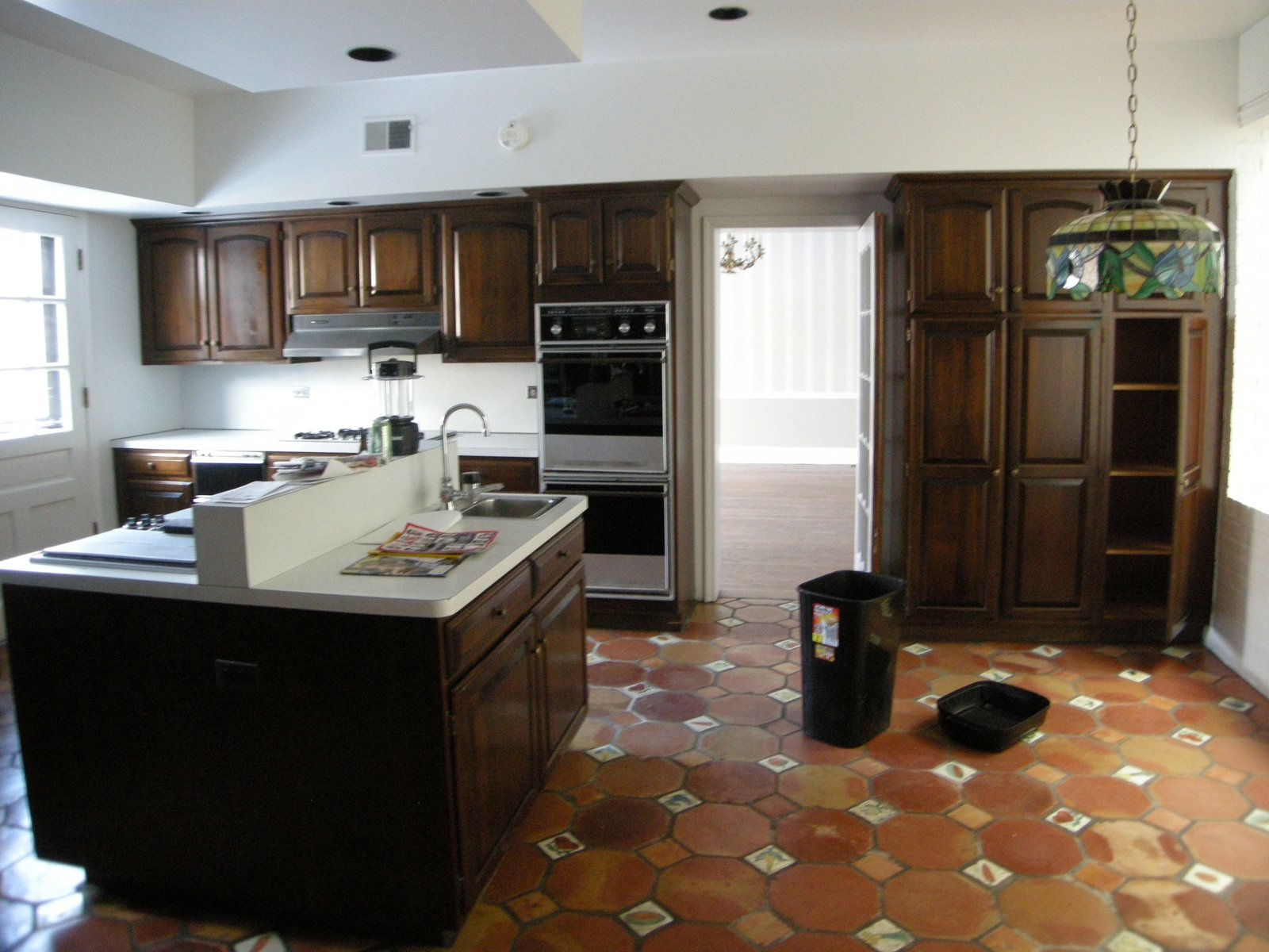 The pre-renovation kitchen. An Impressive 20-Foot Skylight Transforms a Jumbled Chicago Home - Photo 6 of 13